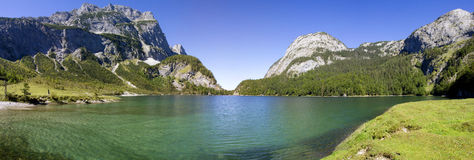 Small lake and mountains panorama Royalty Free Stock Photos