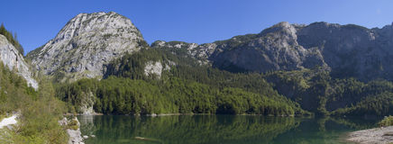 Small lake and mountains panorama Royalty Free Stock Images