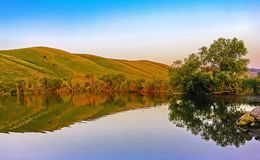 A small lake in the mountains, the picturesque landscape stock images