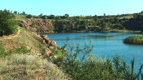 A small lake among the rocks stock video footage
