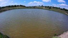 Small lake with small waves. In the summer stock footage