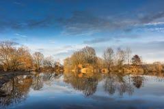 Small lake with sunny orange Royalty Free Stock Photos