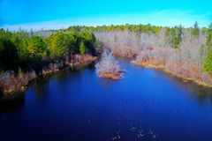Small Lake Surrounded by Trees. And Color Royalty Free Stock Image