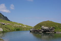 Small lake on Transfagarasan Royalty Free Stock Images