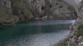 Small lake in the valley of Sagittarius, Scanno Abruzzo Italy. Famous Lake St. Dominic in the valley of Sagittarius, Scanno Abruzzo Italy stock video footage