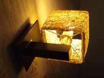 Small lamp with warm light in room interior Stock Photo