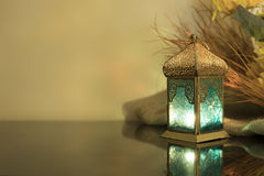 Small Lantern with straw in background. Lantern with blurred straw in background Stock Photography
