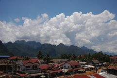 Small Lao Village. Small village in Laos with mountains as background Royalty Free Stock Photography