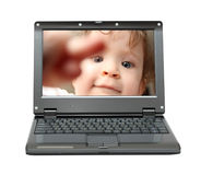 Small laptop with baby Royalty Free Stock Image