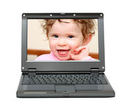 Small laptop with baby Stock Photo