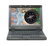 Small laptop with compass and map Stock Photo