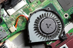 Small laptop computer fan and circuit board. Royalty Free Stock Photography