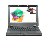 Small laptop with discs and diskettes Stock Images