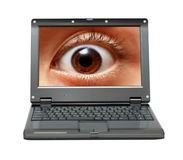 Small laptop with eye on screen Royalty Free Stock Images