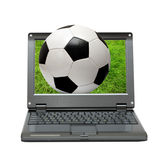 Small laptop with soccer football ball stock photography