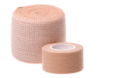 Small and Large Bandages Macro Isolated. Isolated macro image first aid small and large bandages Royalty Free Stock Images