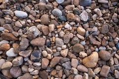 Small and large pebbles for the background stock photography