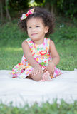 Small latin girl on a green grass park Royalty Free Stock Images