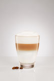 Small latte macchiato with coffee beans Royalty Free Stock Photo