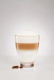 Small latte macchiato with coffee beans royalty free stock photo