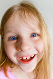 Small laughing girl. Small pretty laughing girl with blue eyes Stock Photo