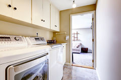 Small laundry area with cabinets Royalty Free Stock Image