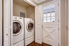 Small laundry area with washer and dryer. Royalty Free Stock Images