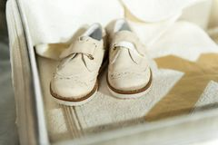 Baby shoes on wooden background royalty free stock photos