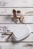 Small leather purse and footwear. Stock Photography
