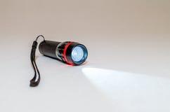 Small led flashlight on white background Royalty Free Stock Images