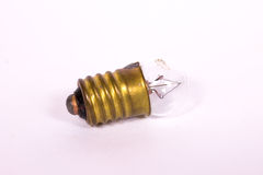 a small light bulb with a brass cap Stock Images