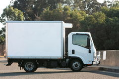 Small light truck with refrigerated container. Small white delivery truck with refrigerated container Stock Images