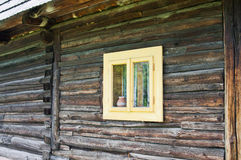 Small light window on a chalet Royalty Free Stock Photography