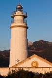 Small lighthouse. And tower in Port de Soller in Mallorca Spain Royalty Free Stock Images