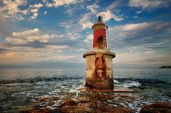 Small lighthouse in the afternoon. A picture of a small lighthouse, guarding the port of San Vincente de la Barquera in Spain, close to the city of Santander Royalty Free Stock Photos