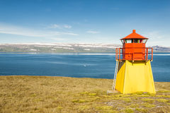 Small lighthouse - Arnarnes, Iceland. Small lighthouse in Arnarnes near Isafjordur town - Iceland, Westfjords Royalty Free Stock Photo