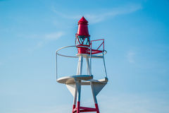 Small lighthouse on blue sky Royalty Free Stock Photo