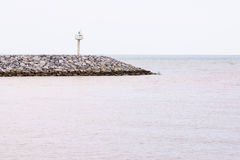 Small lighthouse. At the end of coast of Rayong royalty free stock photography