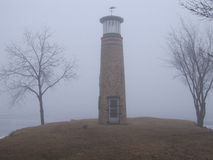 Small Lighthouse in the Fog. Foggy morning at a Lake Winnebago lighthouse Stock Photos