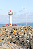 Small lighthouse at Howth harbor in Ireland. Lighthouse at Howth harbor, north of Dublin, Eire Royalty Free Stock Photography