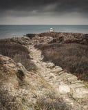 White lighthouse on cliffs Kullaberg royalty free stock photo