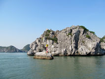 Small lighthouse on limestone rocks royalty free stock photo