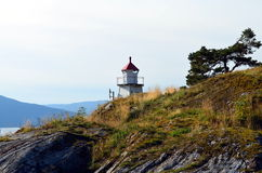 Small lighthouse at a norwegian fjord Royalty Free Stock Image