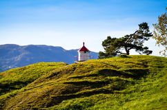 Small lighthouse at norwegian fjord shore Stock Photography