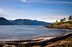 Small lighthouse at norwegian fjord smooth water Royalty Free Stock Photos