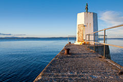 Small lighthouse and pier. Nairn Pier and Harbour, Scotland stock photography