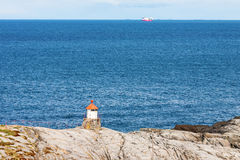 Small lighthouse on the rocky coast Royalty Free Stock Image