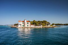Small lighthouse on the sea shore royalty free stock photography