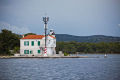 Small lighthouse in a Sibenik bay entrance, Croatia Royalty Free Stock Photography
