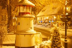 A small lighthouse standing in the city of Ustka royalty free stock image